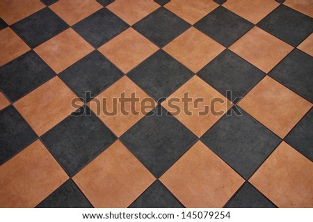terracotta black mosaic tiled floor background - stock photo
