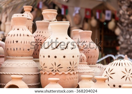 Terracotta pots for sale in Nizwa souk. Sultanate of Oman, Middle East - stock photo