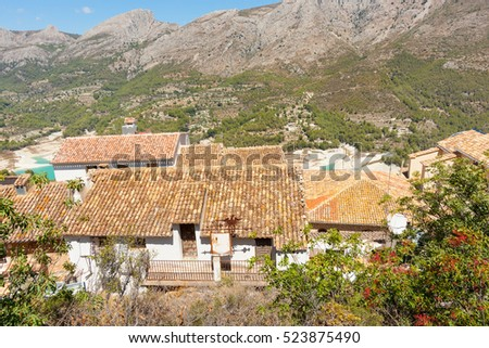 Terracotta roof tops and whitewashed walls typically Mediterranean home architecture in village Guardalest, Spain ancient town with medieval castle ruins set among mountains of Costa Blanca