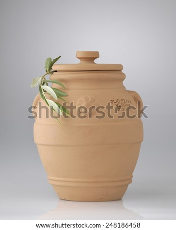 terracotta's pot with cover for extra virgin oil with olive tree  - stock photo