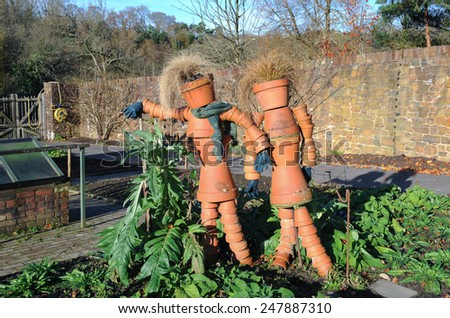 Terracotta Scarecrows made from Flowerpots in the Fruit and Vegetable Garden at Rosemoor, near Bideford, Devon, England, UK - stock photo