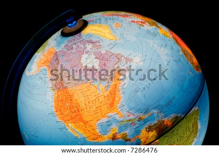 terrestrial globe on black background. - stock photo
