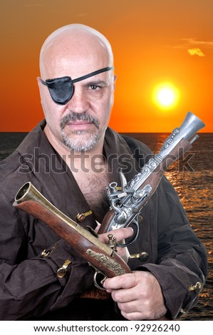 Terrible bearded pirate with a muskets on sunset background