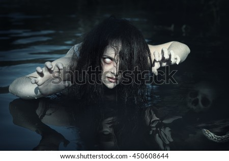 Terrible dead ghost woman in the water outdoor