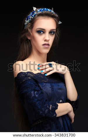 terrible girl with a long face in the diadem. witch conjures. - stock photo