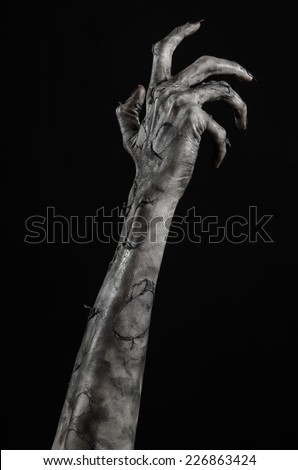 terrible zombie hands, dirty hands of the mummy, zombie theme, halloween theme, black background, isolated, black hand of death with black fingernails, monstrous art - stock photo