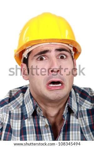Terrified builder - stock photo
