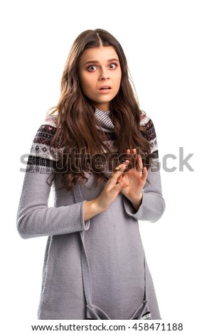 Terrified girl on white background. Patterned long sleeve top. Forget what you saw. Scary truth is uncovered. - stock photo