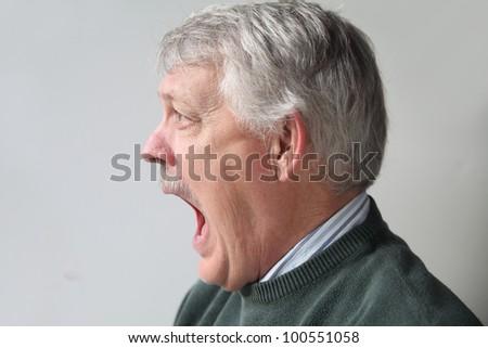 terrified older man - stock photo