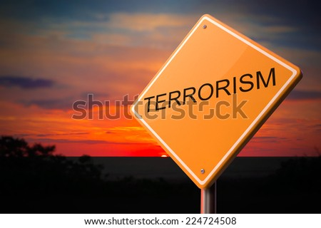 Terrorism on Warning Road Sign on Sunset Sky Background. - stock photo
