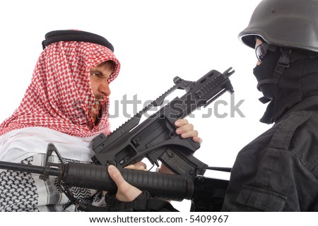 Terrorist and a soldier holding gun. Uniform conforms to special services(soldiers) of the NATO countries.
