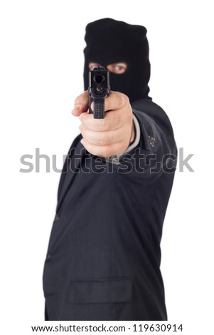 terrorist Business man, with a gun pointing to you. - stock photo