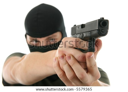 Terrorist holding handgun preparing to fire