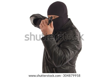 Terrorist in a mask with a gun in the isolate