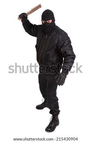 terrorist in black uniform with big knife - stock photo