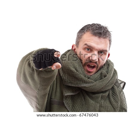 Terrorist pointing his finger for you, isolated on white background - stock photo
