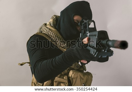 Terrorist sniper shooting with his weapon. Concept about terrorism - stock photo