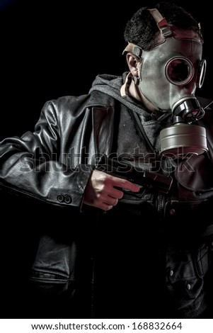 Terrorist, thief, armed man with black leather jacket, dangerous - stock photo