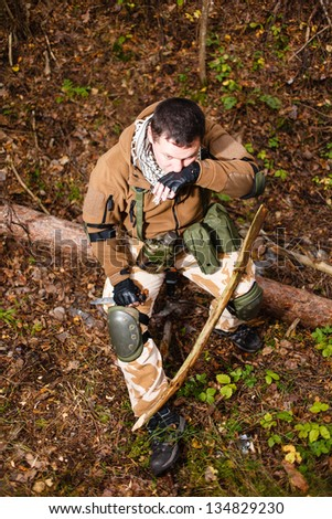 Terrorist with a knife at forest. - stock photo