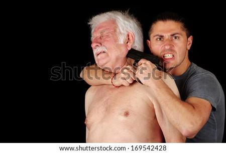 Terrorist with gun and old man  - stock photo