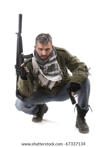 Terrorist with gun, isolated on white background