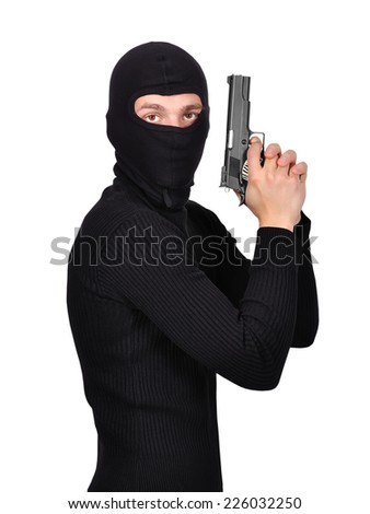 terrorist with gun on a white background - stock photo