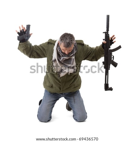 Terrorist with hands up, isolated in white - stock photo