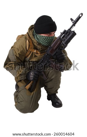 terrorist with kalashnikov rifle with under-barrel grenade launcher isolated on white background - stock photo