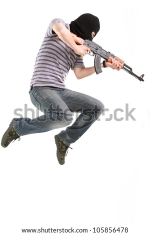 Terrorist with submachine gun. - stock photo