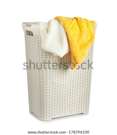 Terry towels in a laundry basket isolated on white background - stock photo