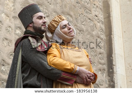 TERUEL, SPAIN - FEBRUARY 21 2014: Participants during rendering of the medieval festival of Bodas de Isabel de Segura recreating the legend of the Lovers of Teruel during the third weekend in February
