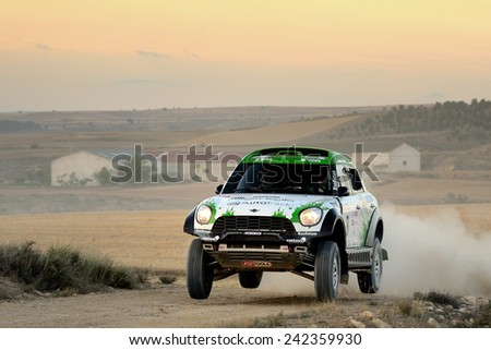 TERUEL, SPAIN - JUL 19 : Dutch driver Erik Van Loon and his codriver Wouter Rosegaar in a Mini ALL4 Racing race in the XXXI Baja Spain, on Jul 19, 2014 in Teruel, Spain. - stock photo