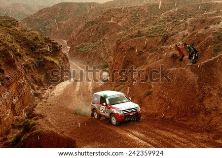 TERUEL, SPAIN - JUL 19 : Italian driver Elvis Borsoi and his codriver Stefano Rossi in a Mitsubishi Pajero race in the XXXI Baja Spain, on Jul 19, 2014 in Teruel, Spain. - stock photo