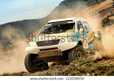 TERUEL, SPAIN - JUL 19 : Kazakhstani driver Kanat Shagirov and his codriver Alexandr Moroz in a Toyota Hilux race in the XXXI Baja Spain, on Jul 19, 2014 in Teruel, Spain. - stock photo