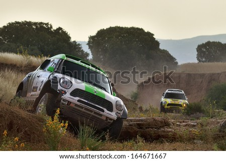TERUEL, SPAIN - JUL 7 : Polish driver Krzysztof Holowczyc and his codriver Andreas Schulz in a Mini All4 Racing race in the XXX Baja Spain, on Jul 7, 2013 in Teruel, Spain.