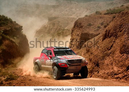 TERUEL, SPAIN - JUL 25 : Portuguese driver Alejandro Martins and his codriver Jose Marques in a Toyota Hilux Overdrive race in the XXXII Baja Spain, on Jul 25, 2015 in Teruel, Spain.