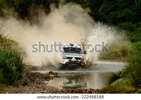 TERUEL, SPAIN - JUL 19 : Spanish driver Santiago Navarro and his codriver Enric Oller in a Mitsubishi L200 race in the XXXI Baja Spain, on Jul 19, 2014 in Teruel, Spain. - stock photo