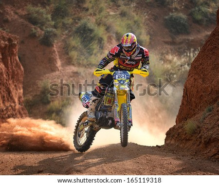 TERUEL, SPAIN - JUL 7 : Spanish rider Jose Manuel Pellicer in a Suzuki RMZ 450 races in the XXX Baja Spain, on Jul 7, 2013 in Teruel, Spain. - stock photo