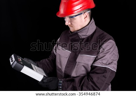Test devices for electric power systems.Test solutions for circuit breakers and batteries. Engineers with experience in power electronics technology.Test and measurement equipment for electric power - stock photo