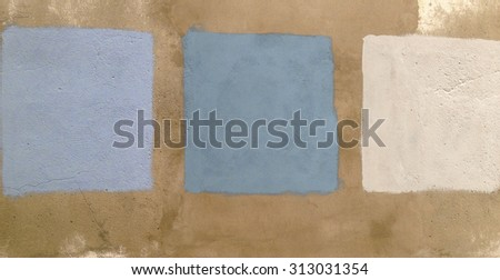 Test of blue colors on an old empty wall with three squares - stock photo