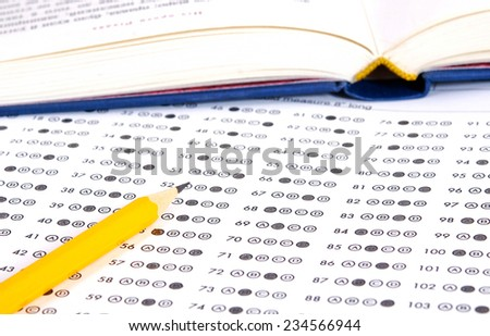 Test score sheet with answers and books - stock photo