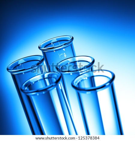 Test Tube Close up. Row of Test Tubes in Blue Tone - Medical Background. - stock photo