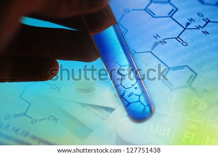 Test tube with formula inside in arm. Macro image with selective - stock photo