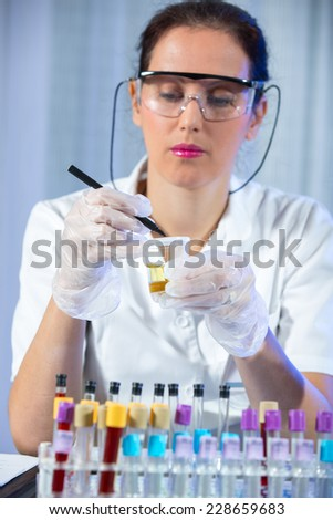 Test tube with urine sample in doctor hand
