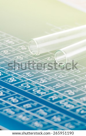 Test tubes and periodic table of elements. - stock photo
