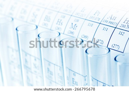 Test tubes and periodic table of elements, science concept - stock photo