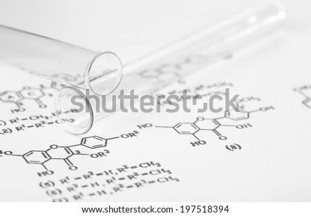 Test tubes and reaction formula, close-up - stock photo