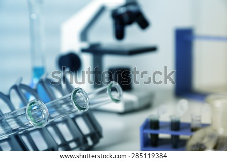 Test tubes closeup..medical glassware.Pipette adding fluid to one of several test tubes .medical glassware. - stock photo