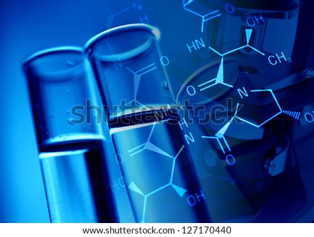 Test tubes in blue tone and formula. - stock photo
