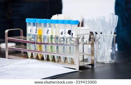 Test Tubes in Rack, Transfer Pipettes Next to Rack
